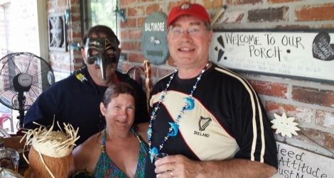 Dang and Lady Yankee with the high priest at the bar christening.